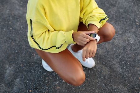 Photo for Detail of sporty woman timing running outdoor workout. Female athlete getting ready for running. Sport and healthy lifestyle concept. - Royalty Free Image