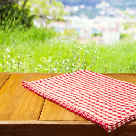 Foto de Background for product montage with tablecloth on wooden table - Imagen libre de derechos