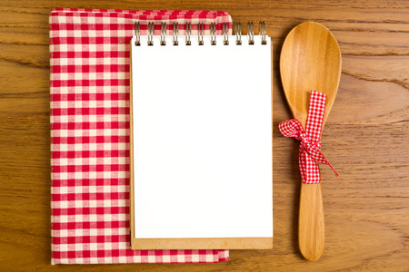 Photo for Blank note book with wooden spoon on tabletop - Royalty Free Image