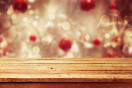 Foto per Christmas holiday background with empty wooden deck table over winter bokeh - Immagine Royalty Free