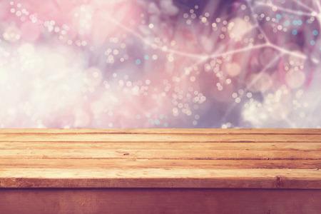 Photo pour Beautiful winter bokeh background and wooden table - image libre de droit