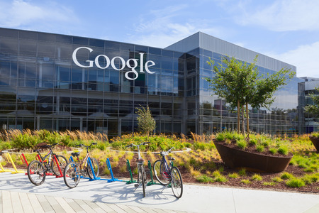 Photo pour MOUNTAIN VIEW, CA/USA - July 14, 2014: Exterior view of a Google headquarters building. Google is an American multinational corporation specializing in Internet-related services and products - image libre de droit