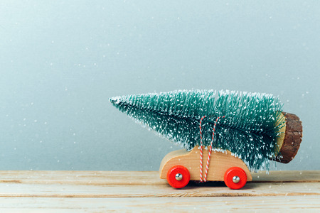 Foto de Christmas tree on toy car. Christmas holiday celebration concept - Imagen libre de derechos