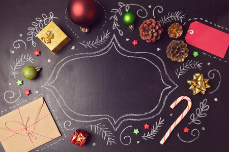 Foto de Christmas holiday background with decorations and hand drawings on chalkboard. View from above - Imagen libre de derechos