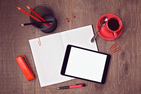 Foto de Top view mock up template of office desk with digital tablet and notebook. Hero header image - Imagen libre de derechos