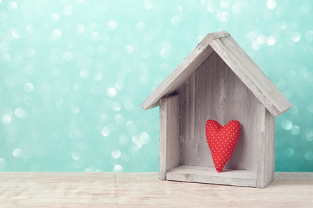 Photo for Valentine's day concept with heart shape and house over rustic background - Royalty Free Image