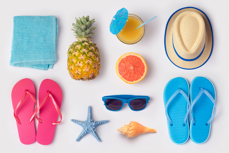Photo pour Tropical summer vacation concept with pineapple, juice and flip flops organized on white background. View from above. Flat lay - image libre de droit