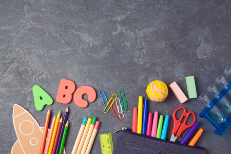 Foto de Back to school background with school supplies.View from above. Flat lay - Imagen libre de derechos