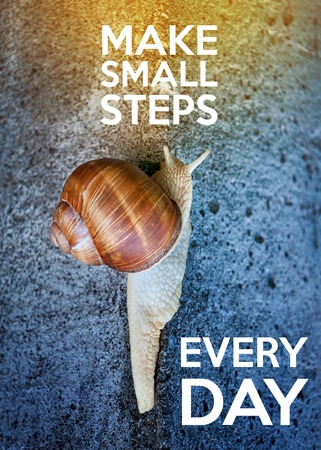 Foto de Inspirational quote with words make small steps every day. Large snail crawling on a stone wall - Imagen libre de derechos
