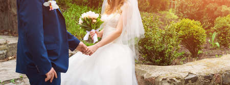 Photo pour Bride and groom on their wedding day. Elegant wedding couple posing together outdoors on a wedding day enjoying romantic moments in the garden. Banner for website. - image libre de droit