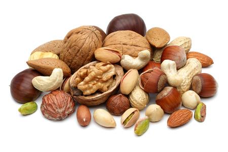Foto de Mixed nuts isolated on white background - Imagen libre de derechos