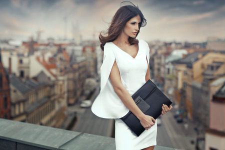 Photo pour Smart businesswoman on the roof of the building - image libre de droit