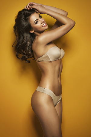 Sensual brunette wearing sexy bikini