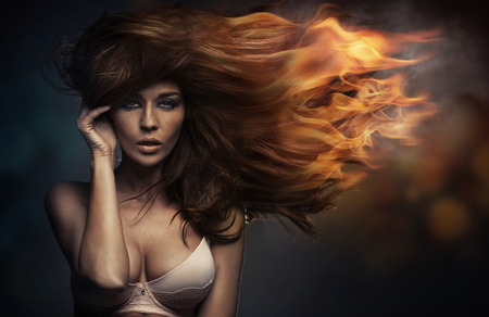Photo for Art portrait of the woman with the flames in hair  - Royalty Free Image