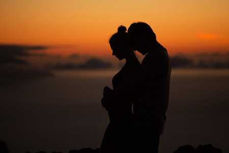 Photo for Silhouettes of the calm, young couple - Royalty Free Image