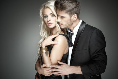 Photo pour Handsome guy hugging his sensual wife - image libre de droit