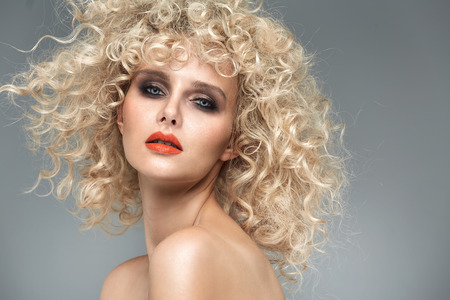 Photo for Beautiful blond woman with gorgeous curly coiffure - Royalty Free Image