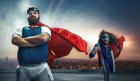 Foto de Funny portrait of two antagonistic super heroes - Imagen libre de derechos
