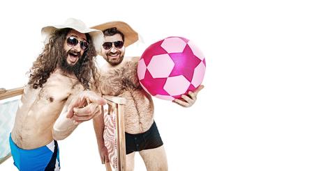 Foto de Portrait of two funny friends on the summer beach - isolated - Imagen libre de derechos