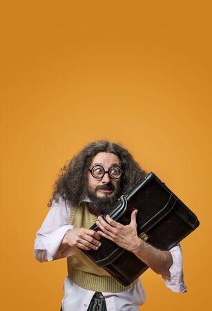 Foto de Portrait of a freaky, cheerful professor holding a briefcase - Imagen libre de derechos