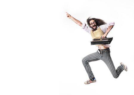 Foto de Potrait of a jumping nerd holding a leather briefcase - Imagen libre de derechos
