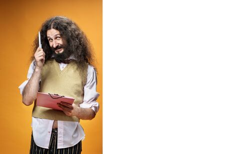 Foto de Funny nerd posing next to the white, commercial board - Imagen libre de derechos