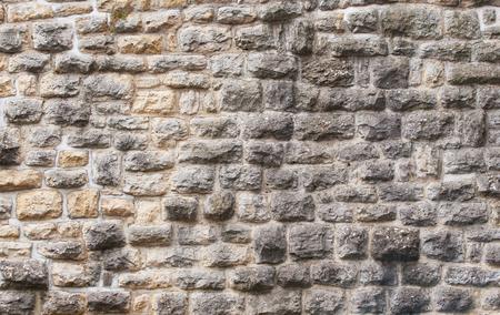 Foto de View of the fortress stone wall close-up, background texture. - Imagen libre de derechos