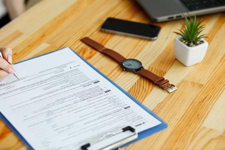 Photo pour Contract waiting for a notary public sign on desk - image libre de droit