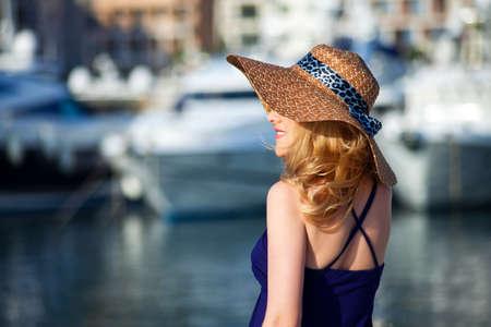 Foto de Attractive woman on yachts background - Imagen libre de derechos