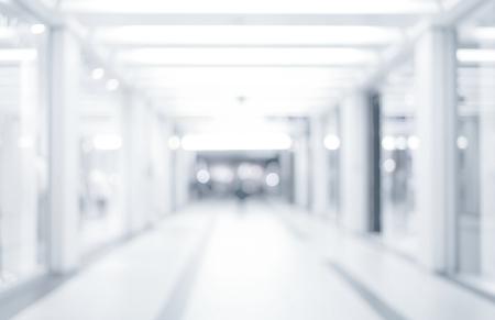 Foto de abstract defocused blurred background, empty business corridor or shopping mall. Medical and hospital corridor defocused background with modern laboratory clinic - Imagen libre de derechos