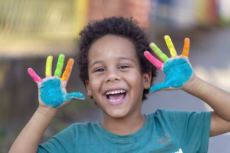Photo for beautifu happy boy with colorful painted hands - Royalty Free Image