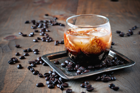 Photo for Liqueur with cream in glasses with coffee beans on a wooden background, alcoholic Mexican drink, selective focus, toned image - Royalty Free Image