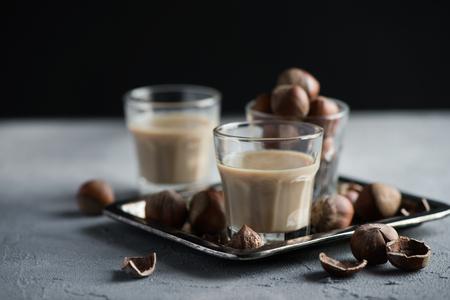 Foto de Cream liqueur with hazelnuts, homemade, selective focus, toned image - Imagen libre de derechos