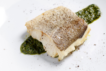 Photo pour Fried fish fillet, Atlantic cod with rosemary in white plate - image libre de droit