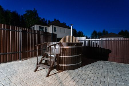 Photo for rural wooden water hot tub with stairs garden yard. . night and starry sky - Royalty Free Image