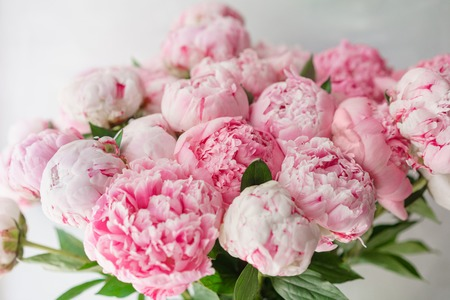 Photo for Beautiful bouquet of pink peonies . Floral composition, daylight. Wallpaper. Lovely flowers in glass vase. - Royalty Free Image