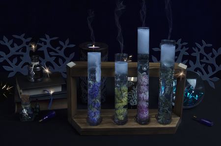 Foto de Magical substances in tubes. Alchemical reaction in progress. Dark ritual - Imagen libre de derechos