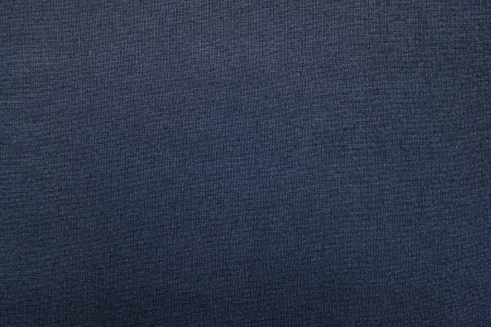 Blue-gray texture of fabric from a textile material for an abstract background, for an empty surface and for wall-paper
