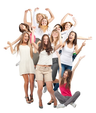 Group of happy young women with raised arms laughing. Isolated on white background