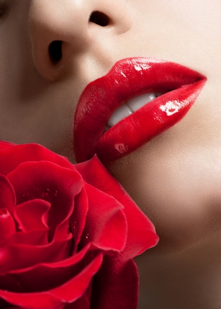 Photo for Close-up shot of sexy woman lips with red lipstick and beautiful red rose - Royalty Free Image