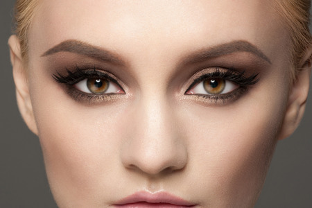 Photo for Closeup image of beautiful woman eyes with fancy bright makeup. Makeup with eyeliner and falce eyelashes - Royalty Free Image