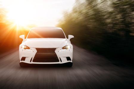 Photo pour Car fast drive on the road at sunset - image libre de droit