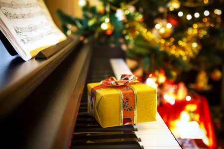 Photo for Christmas gift on piano. Christmas decoration with gift on piano - Royalty Free Image