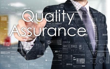 Foto de The businessman is choosing Quality Assurance from touch screen - Imagen libre de derechos