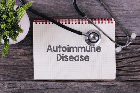 Foto de Autoimmune Disease word on notebook,stethoscope and green plan - Imagen libre de derechos