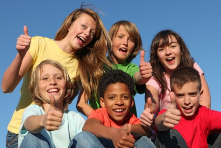 group of diverse kids with thumbs up