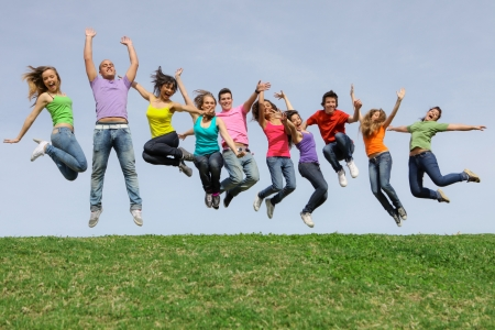 group of teens jumpingat summer camp