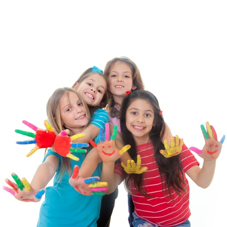 group of happy children having fun with paint