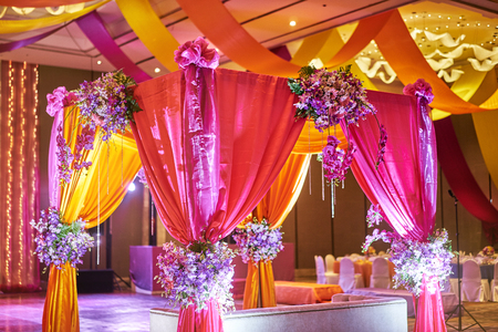 Photo pour The colorful stage decoration with bright shade of color for bride and groom in the sangeet night of traditional Indian wedding - image libre de droit