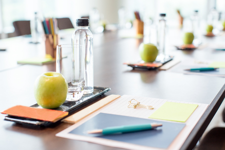 Foto de Conference Table With Water and Stationery - Imagen libre de derechos